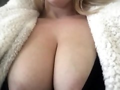 Teasing with her huge natural tits