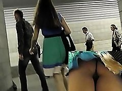 Upskirt voyeur footage of the girl in pleated skirt