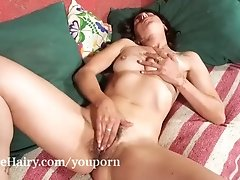 Soledad strips and masturbates on her couch