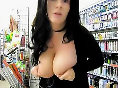 Playing with my big tits in a store