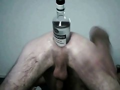 Huge bottle inside his asshole