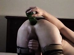 Unusual use of beer bottle